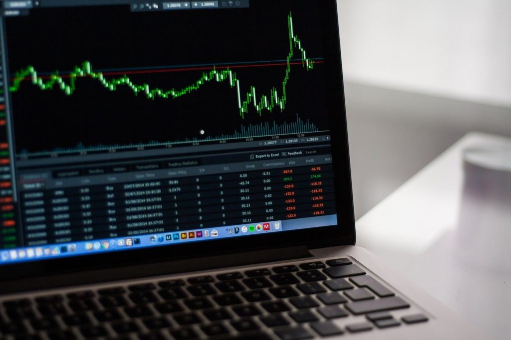Financial trends are shown on a laptop screen